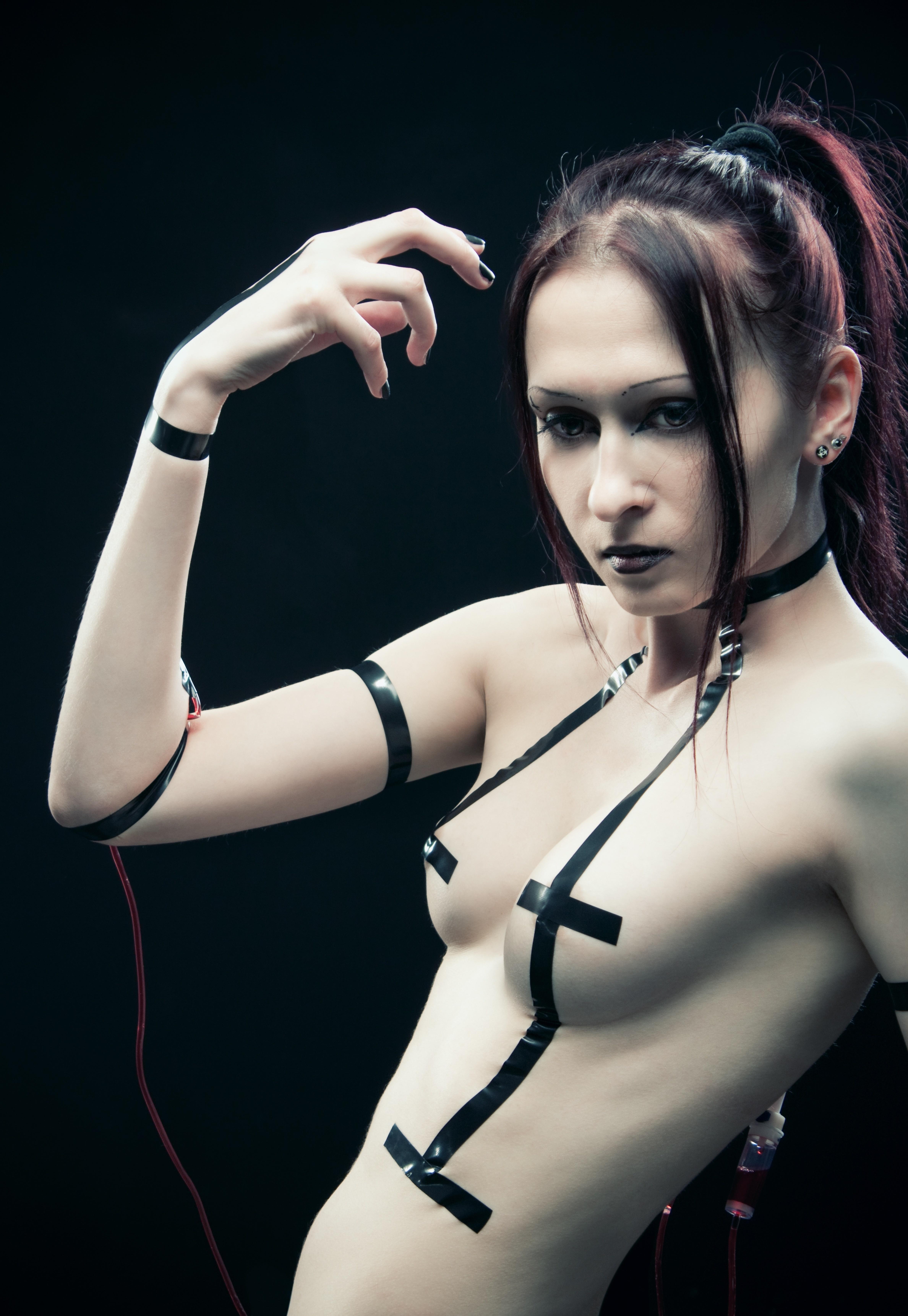 13536634 - pretty futuristic cyber girl posing over dark background